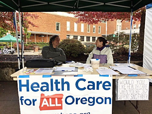 HCAO Eugene volunteers Tim Durant and Erin Knight at the U of O Street Fair