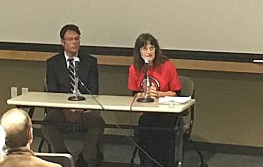 Presenters Dr. Julian Bell and Family Nurse Practitioner Lauri Hoagland address the audience