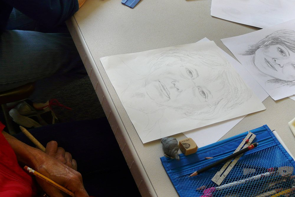 An example from the Portrait Workshop. Using a mirror, rulers, pencils and math equations we created self portraits.