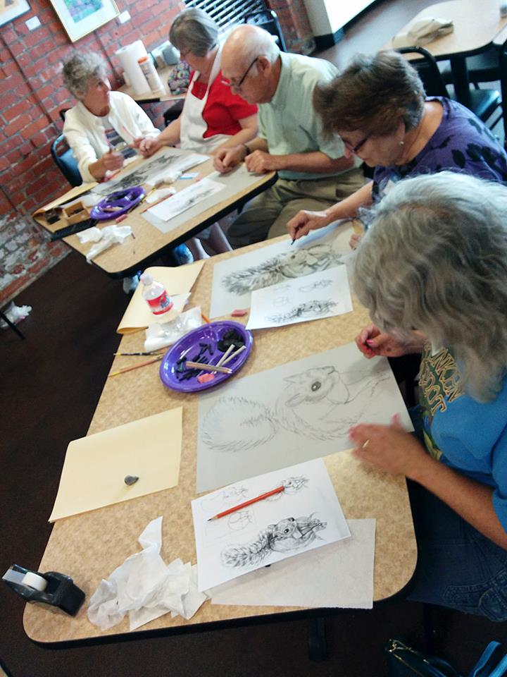 Jill Crowe (top left) instructing us on drawing with charcoal as a medium.