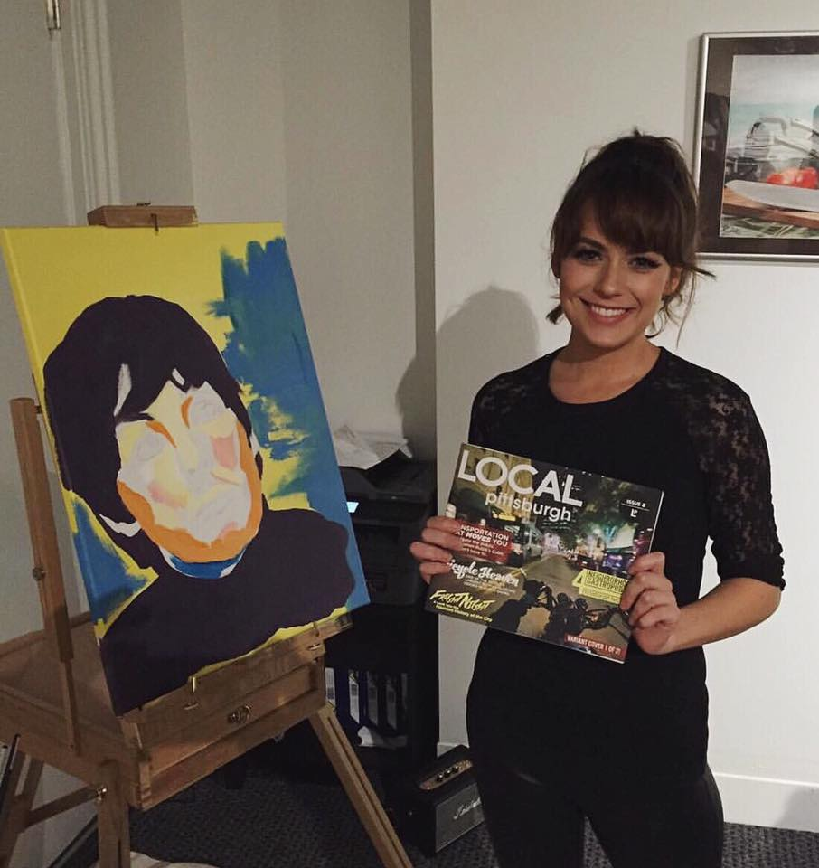 Kait at her solo art show at Chromos Eyewear. Mid live painting Paul McCartney while holding LOCAL magazine where Kait will be featured in their December 2015 issue.