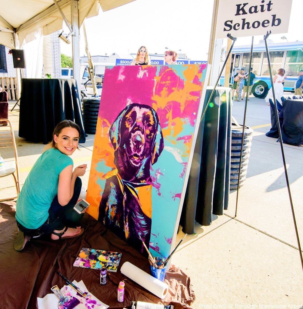 Kait painting during the PAART Dog Days Of Summer Event before it goes to live auction Photo Credit: PAART