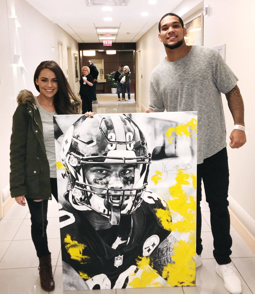 Kait with James Conner and her painting of James