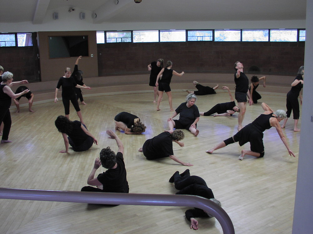 Dancers scatter for an annual dance congress, sharing the Mettler approach to group improve, in Mettler's circular dance space in Tucson AZ.