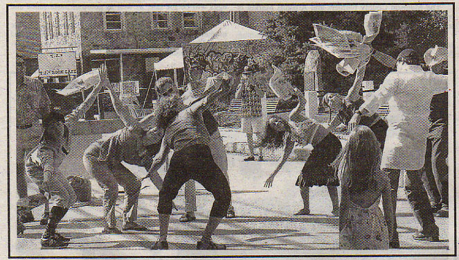 Newspaper dance on mainstreet; bringing the Mettler-based method of group dance to the street. Madison County Celebrates Art street festival.