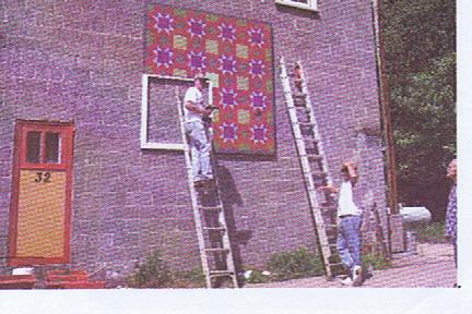 Hung initially on a vacant block bldg wall in downtown Marshall, the quilt held a feature location once the vacant bldg became the town's first tacqueria. In changing hands to a bar, the quilt was painted over by the new tenant, and the community response was SO strong, the arts council collected the panels, and had a high school student restore the original painting which now hangs high on the east side of the Madison County Arts Council building in downtown Marshall.