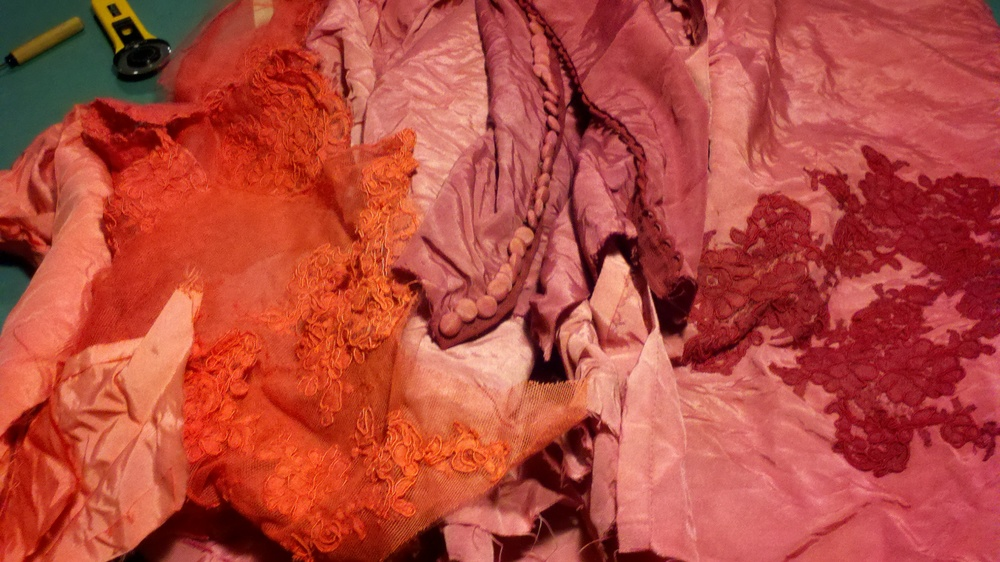 Same stack of wedding gown after a variety of dye baths.