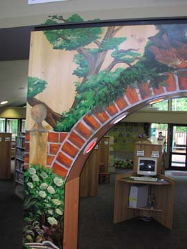 Once installed I came back and painted some of the narrative elements into the Library trim around the arch.