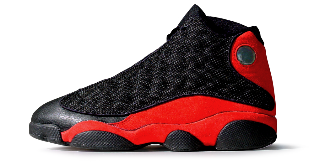 figure 1: In profile, the undulating sculpting of the Air Jordan XIII's Phylon midsole is clearly visible. This sculpting allows the midsole to cradle the foot and contributes to the shoe's exceptional lockdown.