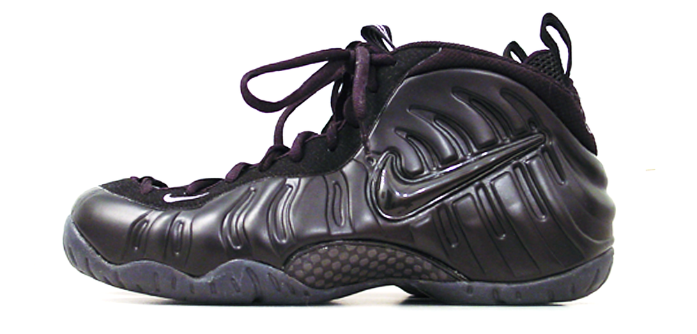 """figure 1:Pictured at the top of this review is the Nike Air Foamposite One in its iconic dark neon royal colorway; directly above is the Air Foamposite Pro in black/black/grey. The Foam One and Foam Pro are functionally identical, but feature some significant aesthetic differences. Most prominent is that the Foam One lacks the Foam Pro's honking huge lateral Swoosh. More subtle are the """"1 Cent"""" logos featured on the Foam One's tongue, heel and outsole—the One features these logos because it was effectively Penny Hardaway's signature shoe for the '97 season."""