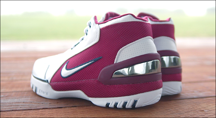 "figure 8.  This shot provides a good look at the large ""bumper"" built into the heel of the Nike Air Zoom Generation. It helps lock down the rearfoot and is a major contributor to the shoe's overall stability. Made of thermoplastic urethane (i.e. heat formed plastic), the bumper and prominent chrome accents scuff very easily, but any damage will be purely cosmetic—the structure is beefy and built to last."