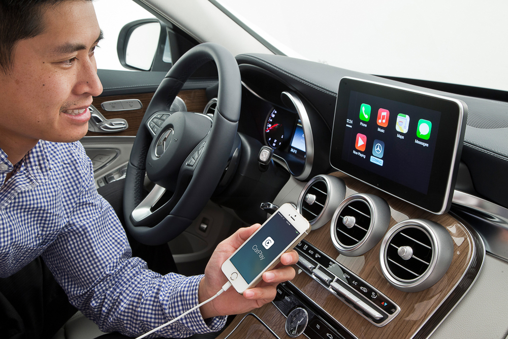 This image, courtesy of Mercedes-Benz, shows an as yet unreleased implementation of CarPlay that should be available in C-Class models before the end of this year. Note that all incarnations of CarPlay demonstrated to date require a wired connection to an in-car USB port, as illustrated here. I think many will find this to be a step backwards from existing Bluetooth hands-free systems, which are completely wireless. Worse yet, unless the manufacturer of your ride offers a post-purchase upgrade to in-car WiFi (something that's laughably unlikely), you'll be stuck using CarPlay with a wired connection for as long as you own your vehicle.