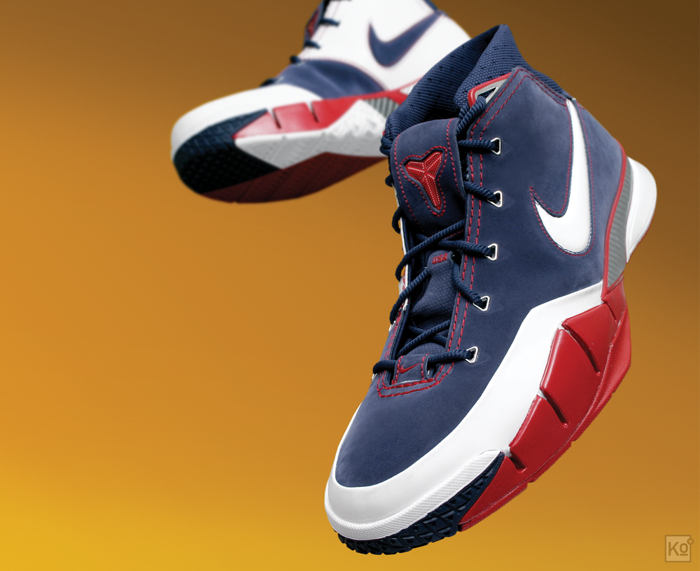 figure 2. This is where Bryant's signature collection with Nike officially kicked off back in 2005: The Nike Zoom Kobe I. Pictured here is the Midnight Navy/White-Varsity Red colorway, better known as the USA. It drew heavily from the shoe Bryant had worn the year prior, the Air Zoom Huarache 2K5, but with a streamlined upper and more extensive use of carbon fiber. It retailed for $130 when it launched, which translates to just under $160 in today's dollars. It was a fantastic playing shoe and would, I think, compare favorably to many of the hoops offerings on the market today from a performance perspective.