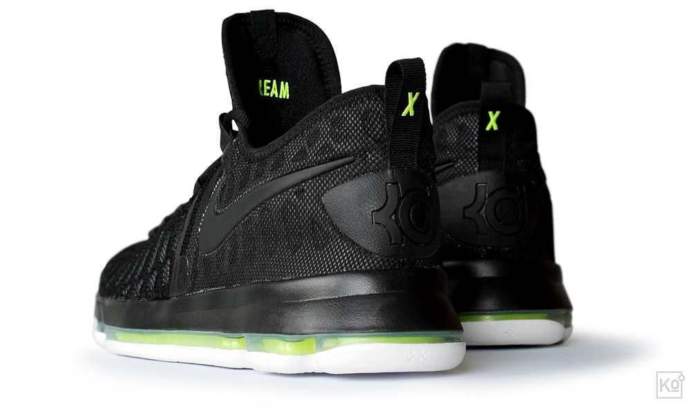 "figure 1. The Zoom KD 9 is surprisingly restrained in its application of overt athlete branding, with this KD logo at the heel representing the only easily visible callout to the shoe's namesake (the iD version shown here is a stealthy black-on-black, but most inline colorways ""pop"" the KD logo to make it more visible). But, as highlighted in this excellent interview with the shoe's designer, Leo Chang, the shoe is rife with more subtle cues. For example, ""the texture on the heel, it's actually inspired by the texture on a handgrip from a camera, because [Durant's] gotten really into photography."" The shoe's performance is also deeply informed by Durant's unique needs, as noted below in the section regarding the shaping of the KD 9's all-new Zoom Air platform."
