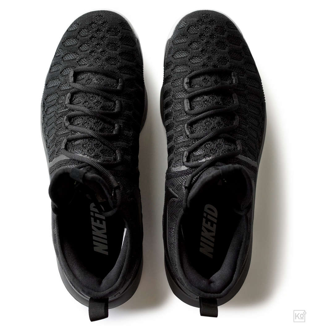 "figure 6. Here's the view of the Zoom KD 9 that you'll get when it's on your feet. The front half of the shoe is constructed of Flyknit that's reinforced with webbing straps (the same straps that you lace into) captured between the Flyknit and a smooth inner lining. This package is engineered to eliminate stretch, but the combination of materials is much more pliable than Nike's previous generation of ""fused"" constructions, which is a good thing because I found the upper to run quite narrow through the forefoot. As someone with wide feet, this meant my first wearing wasn't particularly comfortable, but it felt great thereafter."