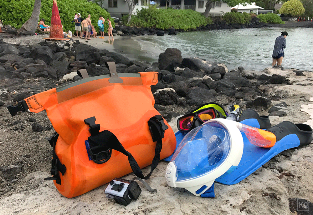 "I'm already at work on reviews of the snorkeling gear we used on this most recent trip to the Big Island and hope to have them posted soon. In the meantime, for the curious, these were the key elements of our kit, starting from the bright orange bag and going clockwise. That orange sack is a fully submersible ""Ocoee"" dry-bag made in the US by a North Carolina-based company called Watershed—it worked like a charm, and I'll explain how I used it in my review. Next to it, in the background, is my SeaVision 2100 dive mask with a prescription CR-39 lens and a magenta color correcting filter—I've had this mask for two years and couldn't be happier with it. Just in front of that is my wife's ""Easybreath"" full-face snorkeling mask—she did experience a couple of small issues with it, which we'll cover in our review, but still far prefers it to a conventional mask-and-snorkel combo. Both masks are sitting atop fins that we rented from Snorkel Bob's for $12 per pair for the entire week. Finally, at the front of the shot is the Sony HDR-AS300 Action Cam that I used to capture the underwater footage in the video embedded above. I'll be reviewing the AS300 as well, but, by way of a preview, I can tell you that I far prefer it to the various GoPro models I've used in the past."