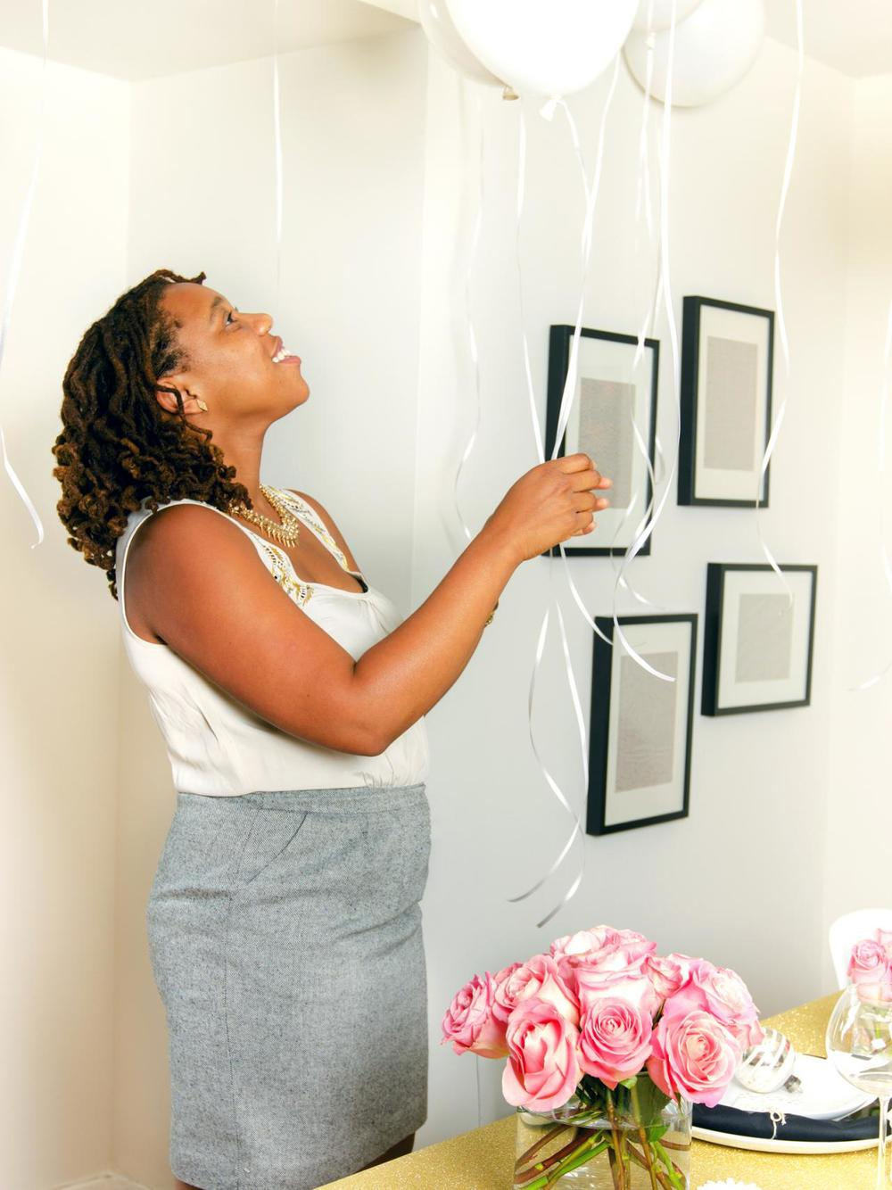 In this photo we wanted to make sure the photographs feel light and airy, which is why we selected white balloons and silver ribbon to play off of the white walls.