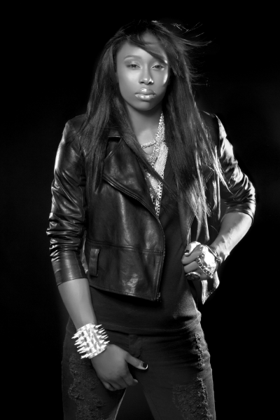 Lindsay Adler Photography... Black on Black with bold accessories is a classic confident look.  WNBA Essence Carson