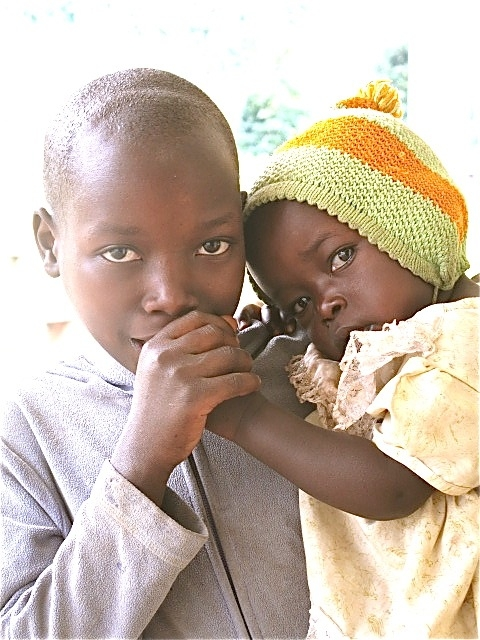 Photo of sisters in Rwanda from a trip I made; I feel the togetherness, love, and strength in the power of this photo.  Photography by Erin Robinson