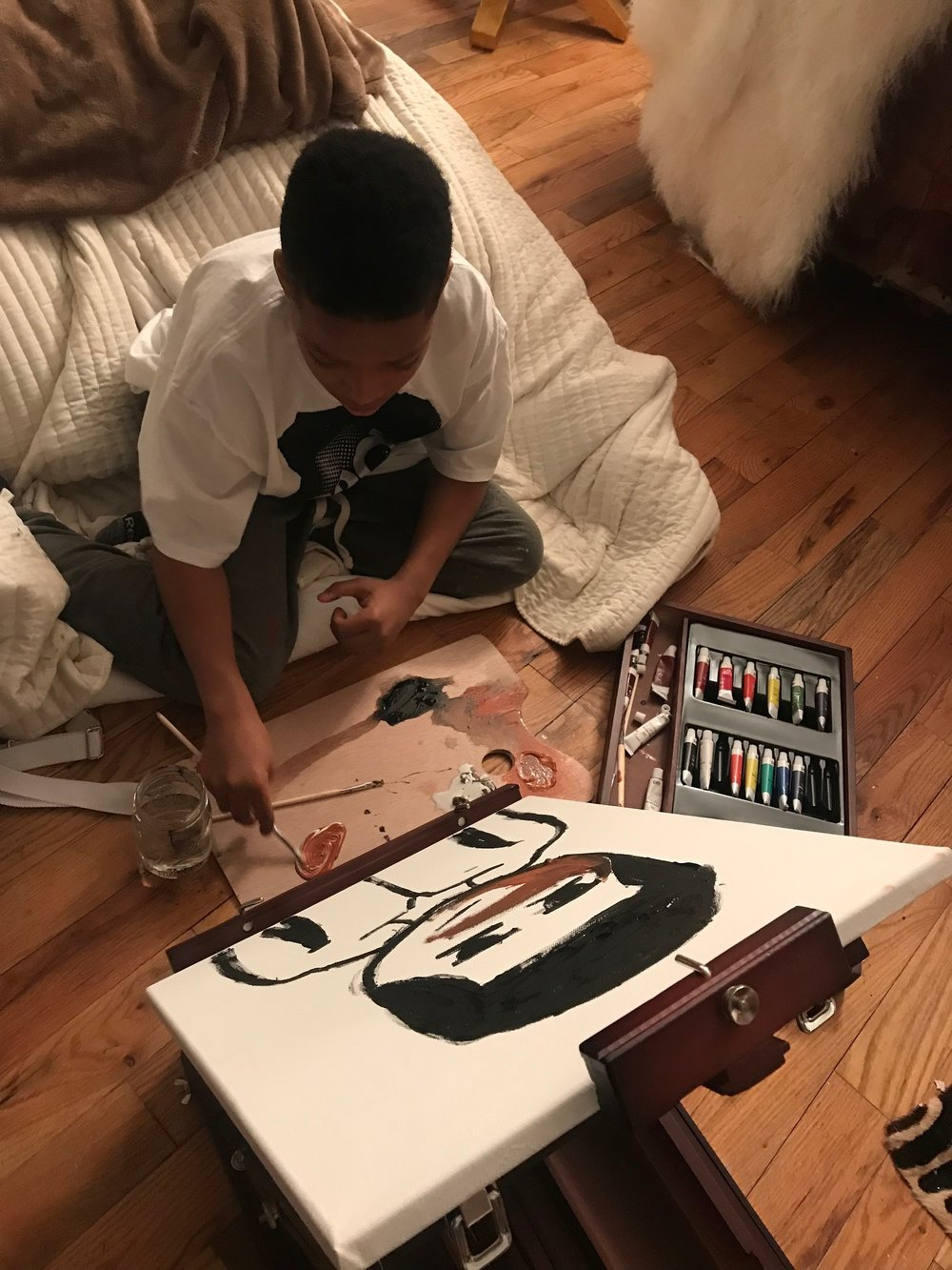 Bailey Li's son painting his self portrait