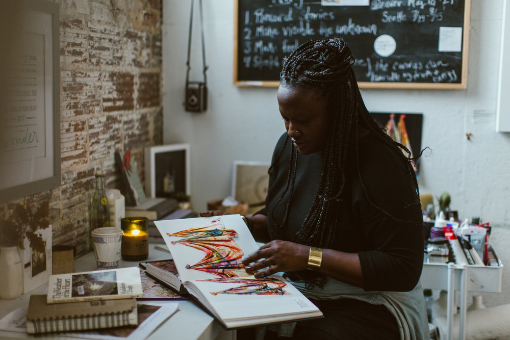 Photo of Lanecia studying the work of Sam Gilliam