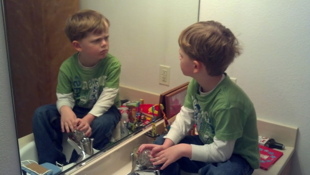 AJ exploring self in mirror.