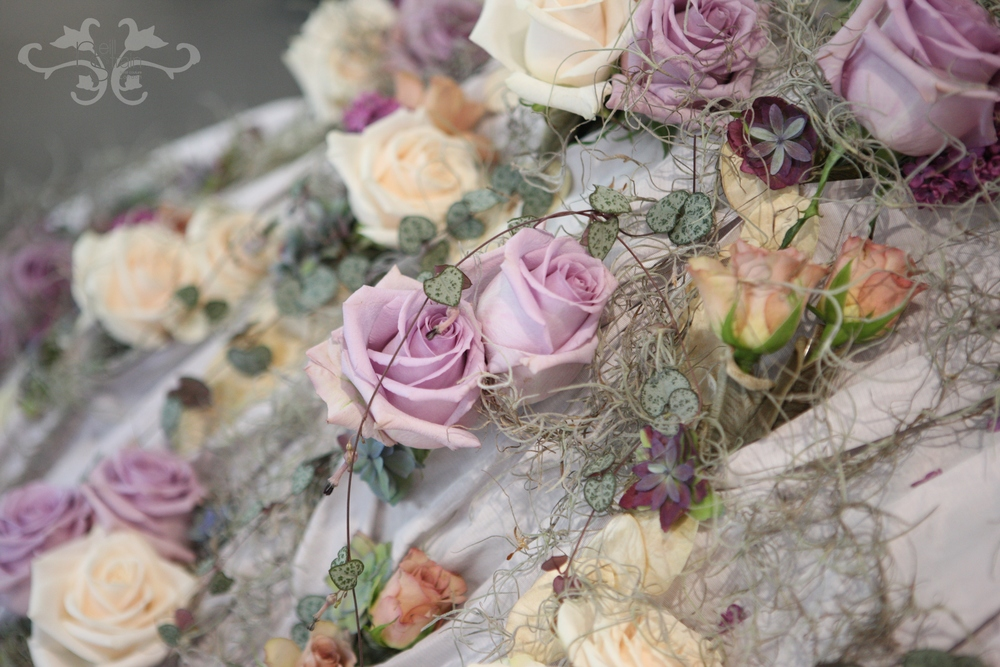 Roses, Spray Roses, Tillandsia, Eucalyptus and Cerepegia Woodi.  .