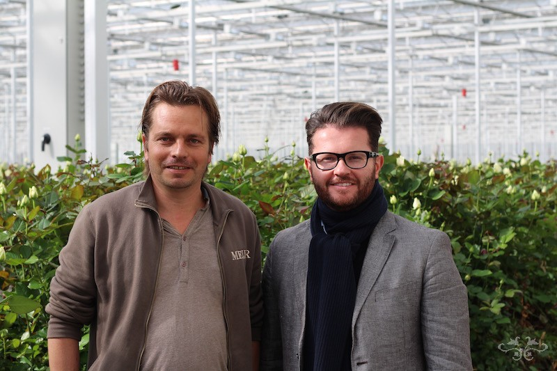 John Meijer with Neill Strain at Meijer's glasshouse in Holland where the Avalanche Roses are grown