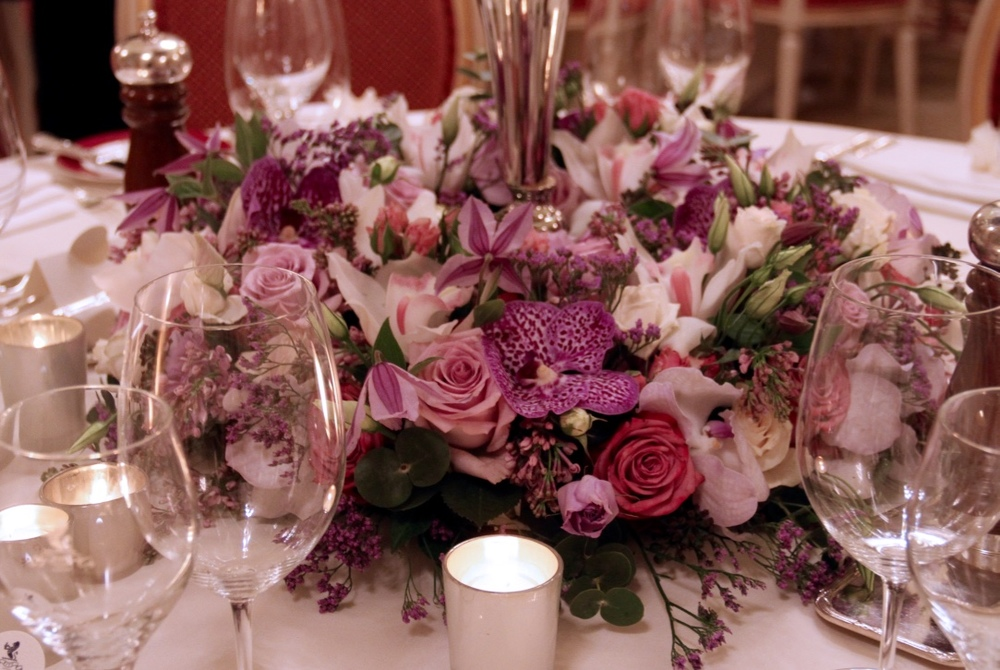 Close up of table floral arrangement at the base of the candelabra.