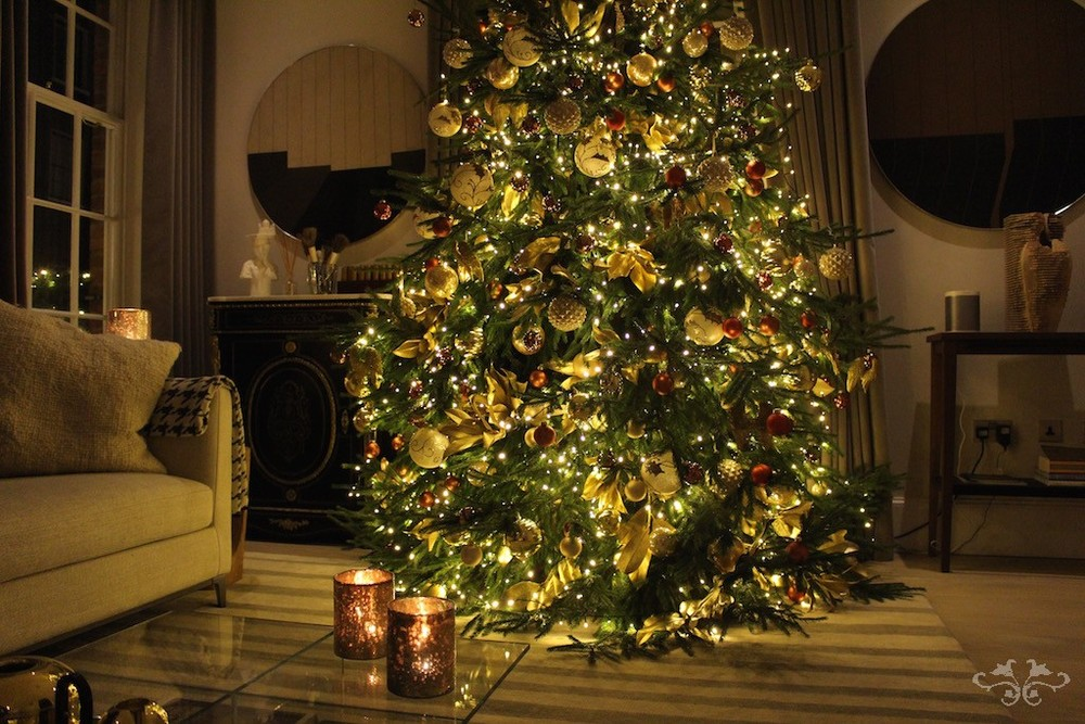 35 meter tall christmas tree lavishly decorated with golden magnolia leaves baubles and ribbons with