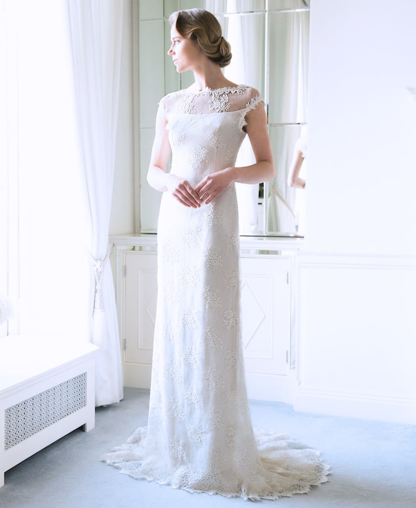 "The 'Caroline"" Fine Lace Ivory Bridal Gown with Beaded Sheer Upper Basque €4995 could be paired with a bouquet of pure white Lily tulips in the spring season capturing the pointed edges of the gown."