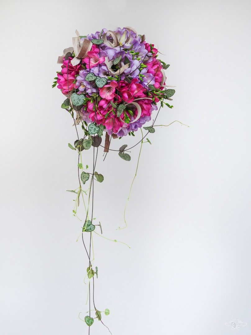 Pomander bridal bouquet with Freesia designed by Neill Strain Floral Couture. Photo by John Nassari