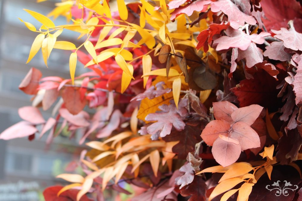 Autumn leaves styled for an impressive urn arrangement