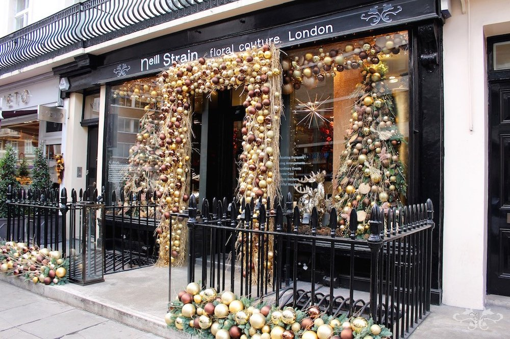 Garlands of baubles in gold, copper and bronze decorate Neill's Belgravia boutique