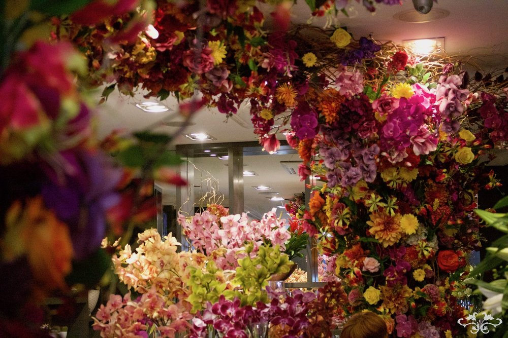 Magnificent range of cut Orchids are displayed under the rainbow of Mexican Frida-inspired flowers.