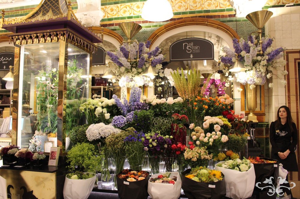 "Neill Strain Floral Couture concession at Harrods displaying the White Gloriosa ""Maria"""