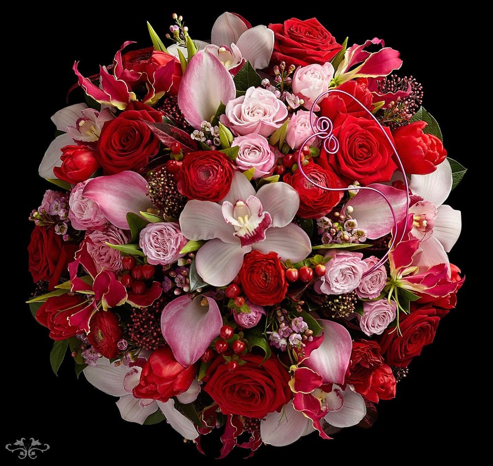 "A stunning tapestry of red Roses, Gloriosa and Calla Lilies mixed with spring flowers is ""Ruby Romance"" for Valentine's Day"