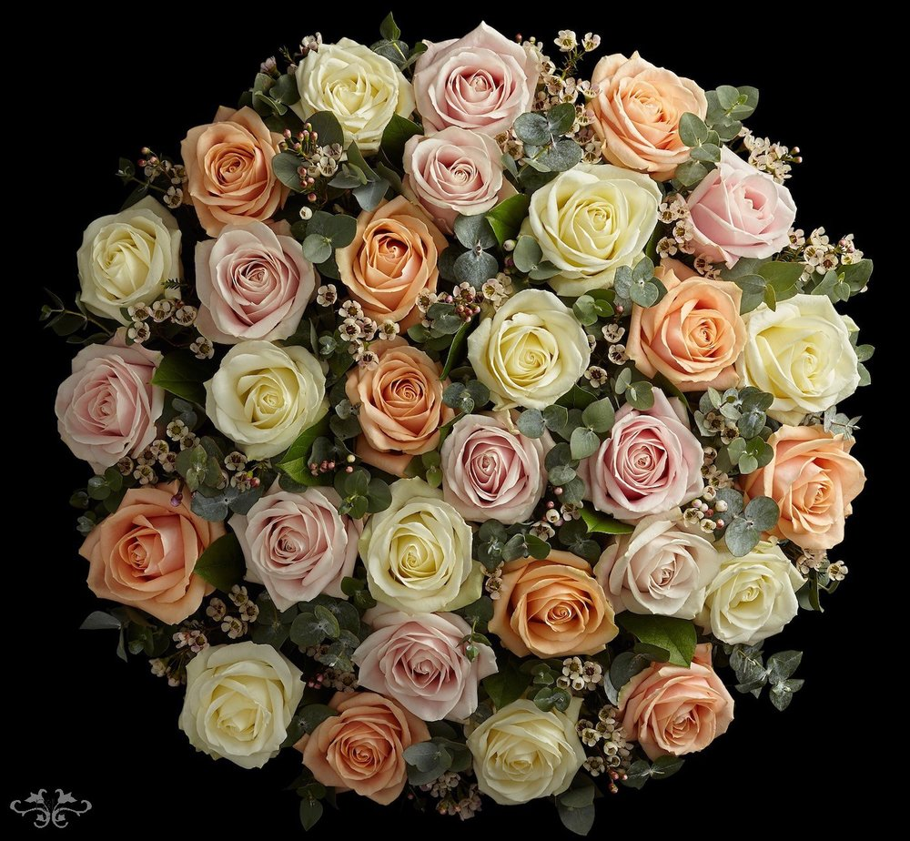 Exquisite bouquet of white, Sweet and Pearl Avalanche Roses for Valentine's Day designed by Neill Strain Floral Couture