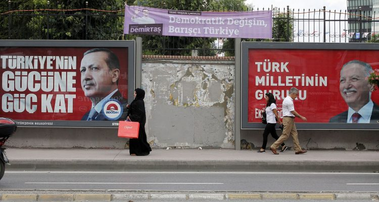 Campaign posters in Turkey, by Osman Orsal (VOA) - Voice of America, Public Domain
