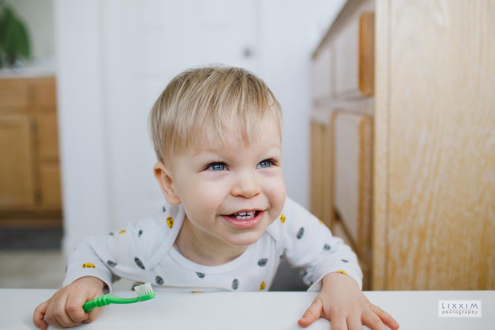 brushing-teeth-15-month-old-toddler-bathroom-kid.jpg