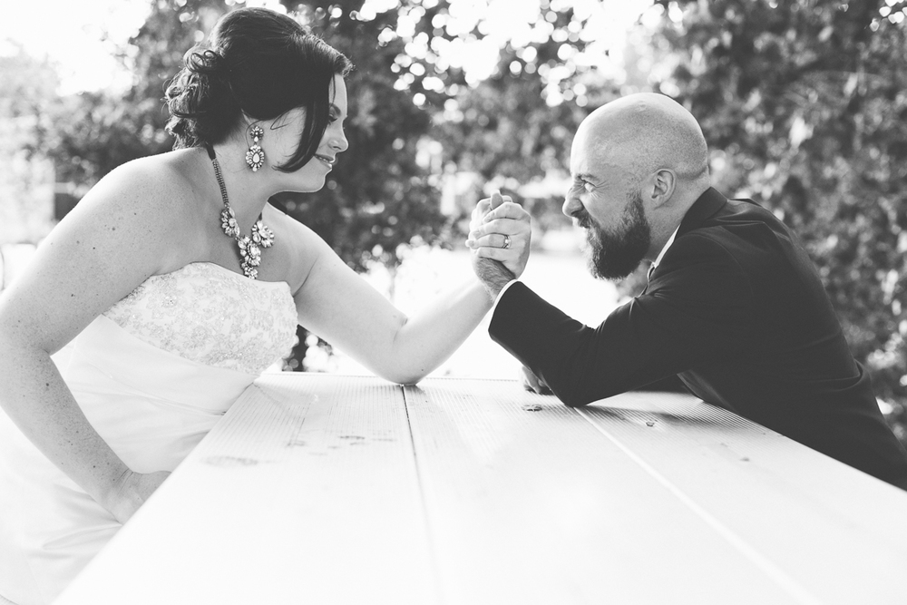 arm-wrestling-bride-and-groom-wedding-day
