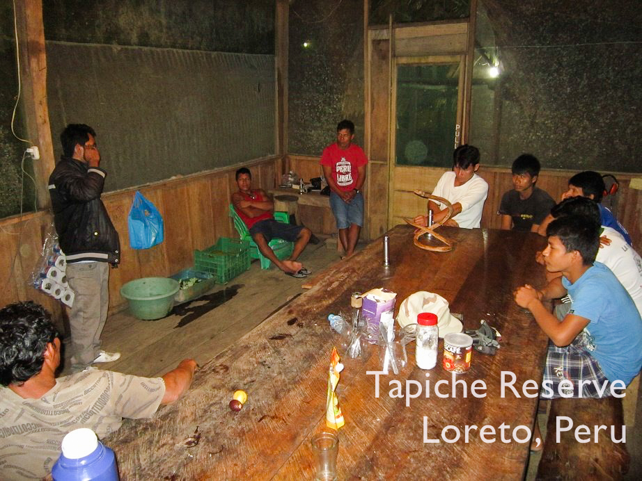 Einstein explains the importance and benefits of eco-harvest to members of local riverside communities. Tapiche Reserve Jungle, Peru