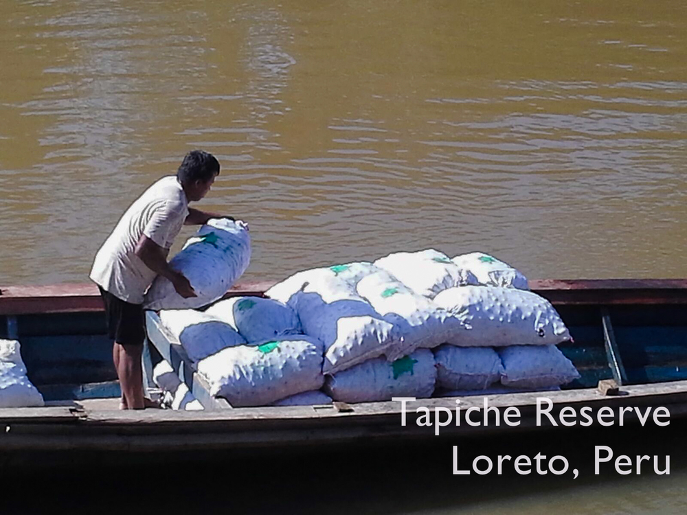 Eco-harvested aguaje fruit is loaded for the 400km journey to Iquitos. Tapiche Reserve Jungle, Peru