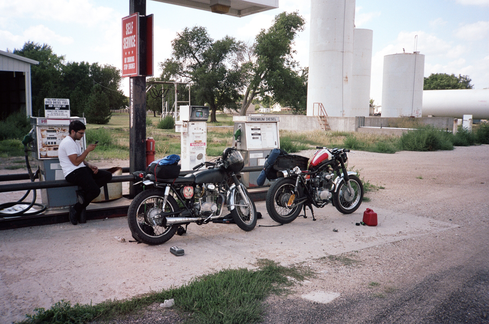 this photo was taken at an abandoned gas station in kansas. better known as a perfect spot to try to find out why my bike had no power. turns out it was the cam chain needing tensioning.   the last post reminded me that i wanted to make a list of all the movies we watched on this trip:   raising arizona / kokomo, in twister / columbia, mo con air / fowler, co armageddon / mt carmel junction, ut rise of the planet of the apes / las vegas, nv kung fu panda / las vegas, nv casino royale / las vegas, nv the bourne identity / las vegas, nv stone / las vegas, nv