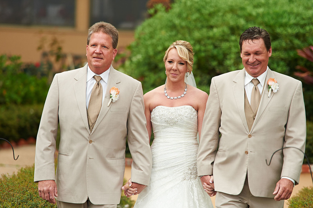 Ashlee walking down the aisle with her uncles.