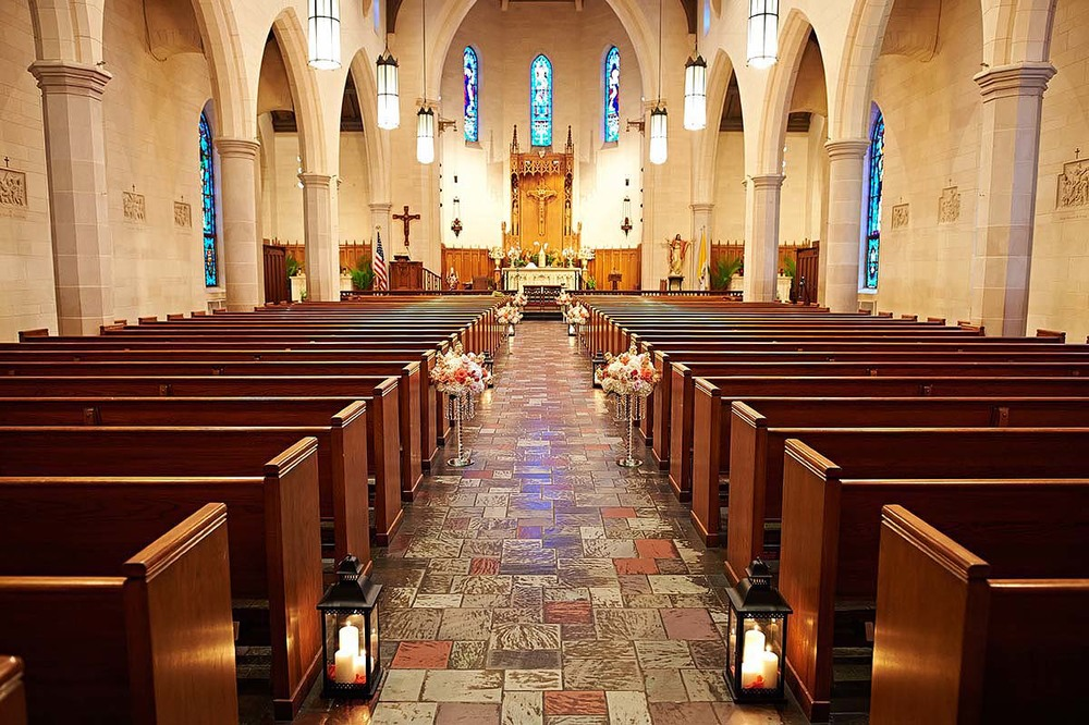 The wedding ceremony was celebrated at the Holy Rosary Church in Downtown Houston, TX.