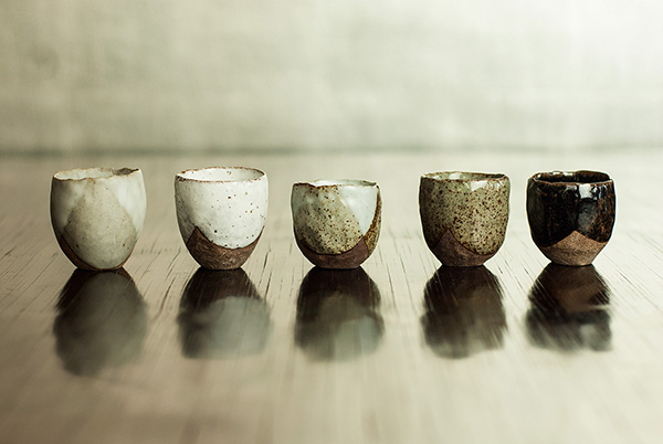 Sake Cups, they appear to float on the surface of the lacquered table. The wall behind is also lacquered, on top of real silver leaf.