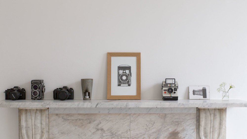 The back wall features a large white marble mantelpiece, useful for displaying objects.