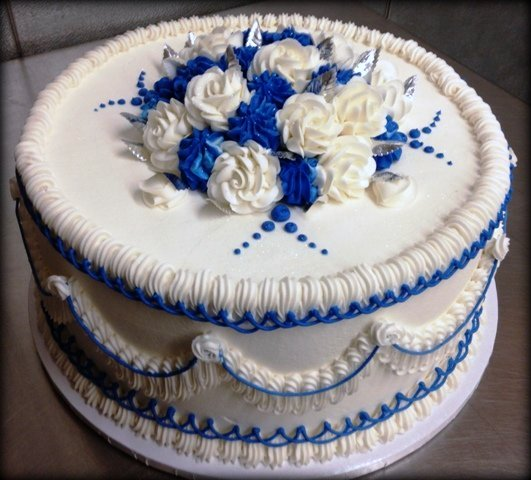 Round Cake with Blue Ruffles and Flower Mound