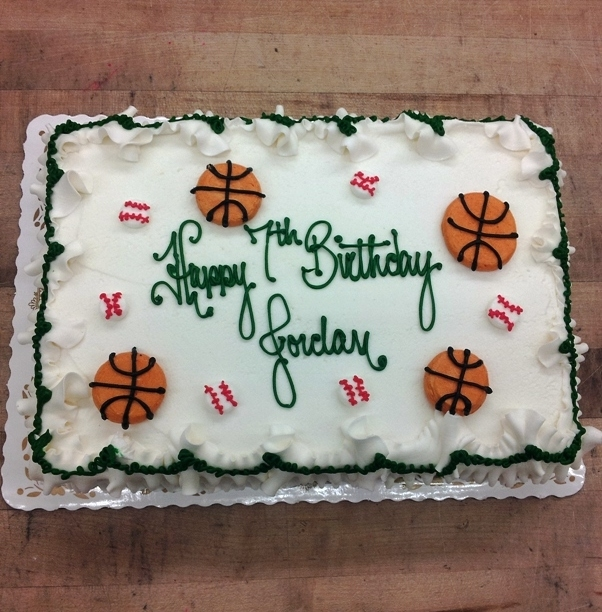Sheet Cake with Piped Basketballs and Baseballs